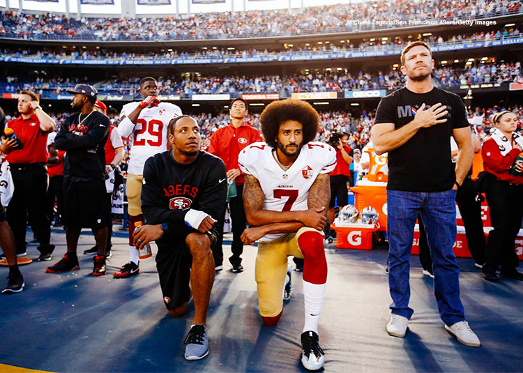 Colin Kaepernick kneeling during national anthem photo credit Michael Zagaris San Francisco 49ers Getty Images 750x489