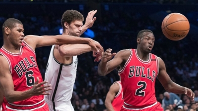 In a rough and tumble game, Brook Lopez (center), Chicago Bulls forward Cristiano Felicio (6) and guard Jerian Grant (2) battle for the ball on Saturday, April 8, 2017, the Nets last home game of the 2016-17 NBA season. The Nets beat the Bulls 107-106.