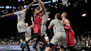 Brooklyn Nets guard Caris LeVert  attempting to block shot by Toronto Raptors guard DeMar DeRozan (10) on January 17, 2017