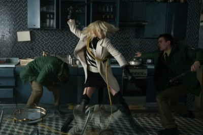 Charlize Theron (center) fighting off assailants in the movie, Atomic Blonde.