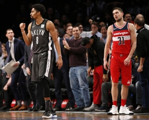 Spencer Dinwiddie, Brooklyn Nets point guard (left) feeling good, with Wizards' Tomas Satoransky (right) looking on as Nets pull off a 103-98 win over the Washington Wizards.