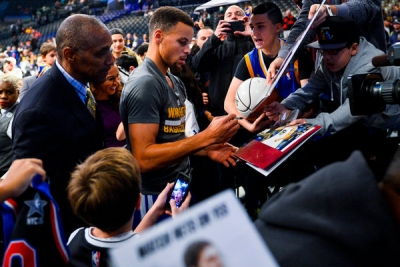 Golden State Warriors guard Stephen Curry signing autographs for fans prior to  game with the Brooklyn Nets at the Barclays Center on December 6, 2015
