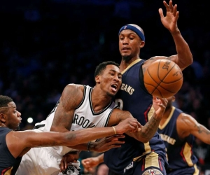 Brooklyn Nets forward Rondae Hollis-Jefferson (center) is double-teamed by two New Orleans Pelicans players, forward Terrence Jones on the left, and forward Dante Cunningham (33).