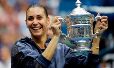 Italian Flavia Pennetta holds US OPEN 2015 trophy after defeating fellow Italian Roberta Vinci, 7-6, 6-2