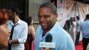 Actor Anthony Anderson on the red carpet talking with What's The 411TV's reporter, Crystal Lynn, at Justin Tuck's Celebrity Billiard's Tournament