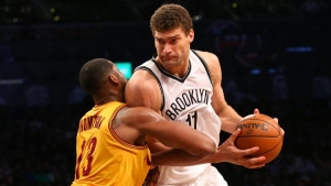 Brooklyn Nets center Brook Lopez drives against Cleveland Cavaliers center Tristan Thompson during the fourth quarter at Barclays Center