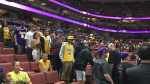 Los Angeles Lakers fans lining up to take photos with LaVar Ball