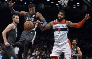 Photo  Rondae Hollis-Jefferson, Brooklyn Nets forward (center), competes for the ball with Washington Wizards' forward Markieff Morris (right) during the first half of an NBA basketball game Friday, Dec. 22, 2017, at the Barclays Center in Brooklyn, NY.