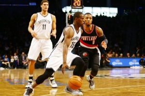 Isaiah Whitehead being defended by Portland Trail Blazers guard Damian Lillard with Brook Lopez in background