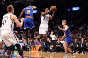 Sean Kilpatrick, Brooklyn Nets shooting guard, goes to the basket surrounded by New York Knicks players.