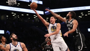 Brooklyn Nets guard Allen Crabbe (right) trying to stop Golden State Warriors guard Klay Thompson from scoring in a game at the Barclays Center on Sunday.