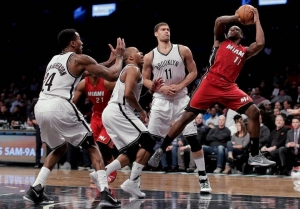 Miami Heat guard Dion Waiters (11) is shooting around Brooklyn Nets players in second quarter during NBA game at Barclays Center in Brooklyn on January 25, 2017