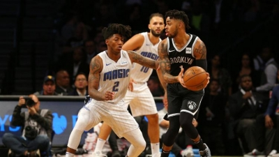 D'Angelo Russell gets by Magic's Elfrid Payton in Nets home opener