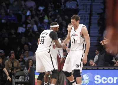 Trevor Booker and Brook Lopez celebrate as Brooklyn Nets cruise by the Orlando Magic 121-111 on April 1, 2017. No April Fools' joke.