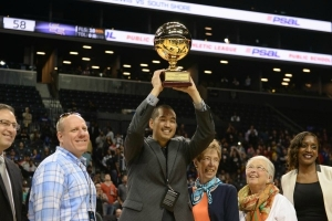 Francis Lewis High School Girls Basketball Head Coach, Stephen Tsai, hoisting PSAL AA Divison Girls Basketball Championship trophy