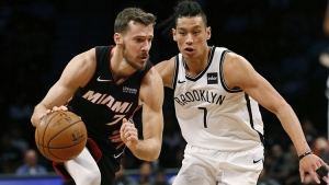 Brooklyn Nets guard Jeremy Lin guarding Miami Heat's Goran Dragic(left). Nets defeat Heat 107-88