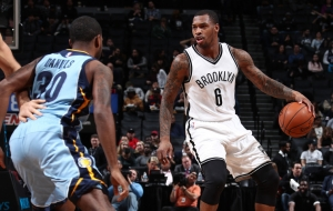 Brooklyn Nets shooting guard Sean Kilpatrick holding off Memphis Grizzlies shooting guard Troy Daniels at a game at the Barclays Center on February 13, 2017.