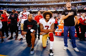 Colin Kaepernick kneeling during the National Anthem prior to a San Francisco 49ers game