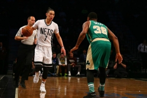 Nets guard Jeremy Lin bringing the ball up and being defended by Celtics guard Marcus Smart