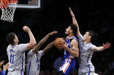 Brooklyn Nets center Brook Lopez (11) and guard Isaiah Whitehead (15) and guard Jeremy Lin (7) defending Philadelphia 76ers guard Timothe Luwawu-Cabarrot (20) during game at Barclays Center on March 28, 2017.