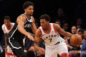 Brooklyn Nets point guard Spencer Dinwiddie guarding Kyle Lowry of Toronto Raptors at Barclays Center on January 8, 2018.