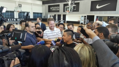 Brooklyn Nets guard Jeremy Lin surrounded by the New York media