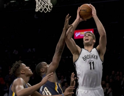 Brook Lopez going up for basket in Brooklyn Nets 120-110 win over the Indiana Pacers