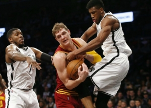 Photo: Thaddeus Young, Brooklyn Nets forward, tries to strip ball from Cleveland Cavaliers center Timofey Mozgov