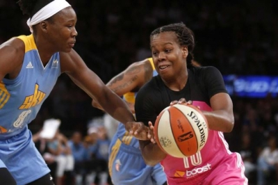 Epiphanny Prince defending the ball against a Chicago Sky player