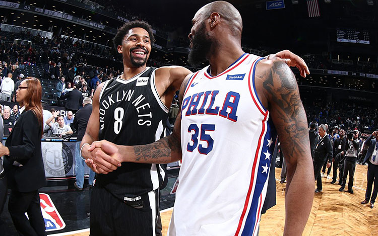 Spencer Dinwiddie shaking hands with former teammate Trevor Booker 750x469