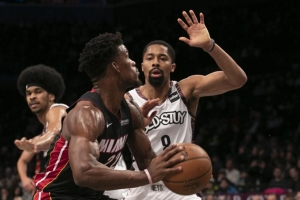 Brooklyn Nets point guard Spencer Dinwiddie on defense against Miami Heat forward Jimmy Butler, with Nets center Jarrett Allen at the ready at the Barclays Center on Sunday, December 1, 2019.