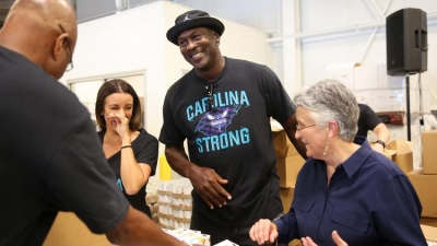 Charlotte Hornets chairman Michael Jordan helping volunteers serve North Carolina residents uprooted by Hurricane Florence