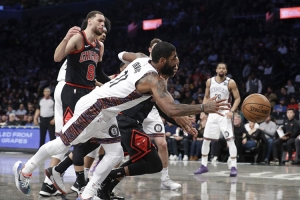 Kyrie Irving, Brooklyn Nets guard, scrambles for the ball, scores 54 points in Nets 133-118 victory over Chicago Bulls