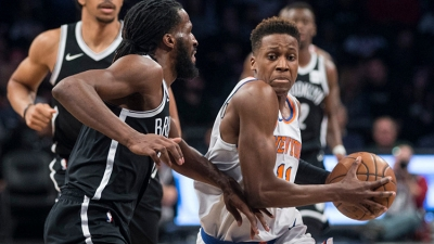 Brooklyn Nets forward DeMarre Carroll (left) trying to stop NY Knicks rookie guard Frank Ntilikina