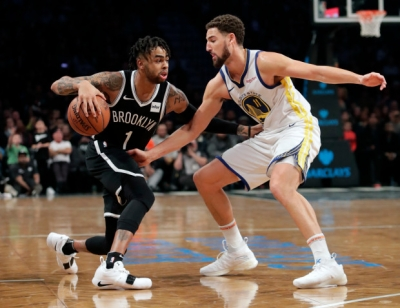 Brooklyn Nets guard D'Angelo Russell pushing past Golden State Warriors guard Klay Thompson at the Barclays Center on Sunday, October 28, 2018.