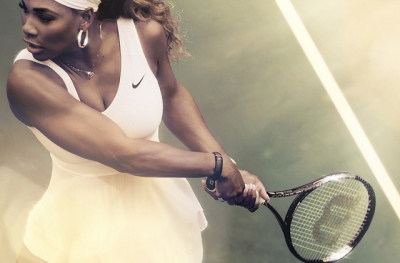 Legendary professional tennis player, Serena Williams, wearing a Nike tennis dress