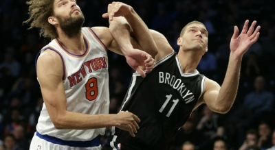 Brooklyn Nets center Brook Lopez muscling out his twin brother New York Knicks center Robin Lopez