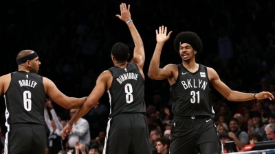 Brooklyn Nets players Jared Dudley (left), Spencer Dinwiddie (center), and Jarrett Allen giving each other high-fives during the Nets game against the Phoenix Suns on Sunday, December 23, 2018. The Nets won 111-103