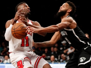 Brooklyn Nets guard Allen Crabbe forces Chicago Bulls guard David Nwaba to turn the ball over at the Barclays Center on April 9, 2018. The Nets defeated the Bulls 114-105.