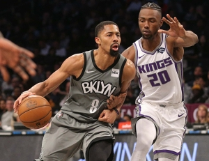 Brooklyn Nets guard Spencer Dinwiddie holds off Sacramento Kings forward Harry Giles III during an NBA basketball game at the Barclays Center on November 22, 2019. The Brooklyn Nets defeat the Sacramento Kings 116-97.