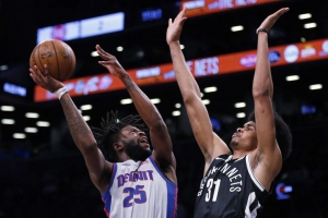 Brooklyn Nets rookie center Jarrett Allen defends basket against Detroit Pistons guard Reggie Bullock.