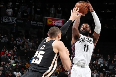 Kyrie Irving, Brooklyn Nets point guard, scores over Atlanta Hawks center Alex Len, and leads the Brooklyn Nets to a 108-86 victory on Sunday, January 12, 2020, at the Barclays Center in Brooklyn, NY.