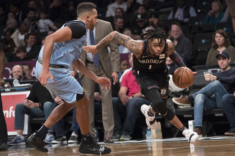 Brooklyn Nets guard D'Angelo Russell moving past a Memphis Grizzlies' defender