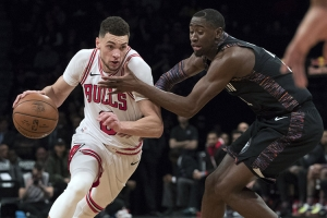 Brooklyn Nets guard Caris LeVert (right) defending against Chicago Bulls guard Zach LaVine
