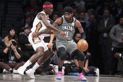 Brooklyn Nets guard Kyrie Irving holding off New Orleans Pelicans guard Jrue Holiday at the Barclays Center on Monday, November 4, 2019.  Brooklyn Nets defeat the New Orleans Pelicans 135-125