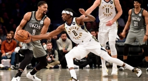 Brooklyn Nets guard Spencer Dinwiddie (left) defending the ball game against Indiana Pacers guard (#8) Justin Holiday at an NBA game at the Barclays Center, in Brooklyn, NY on November 18, 2019. The Brooklyn Nets lost 115-86.