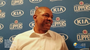 Doc Rivers talking with reporters at the Barclays Center in Brooklyn prior to a game with the Brooklyn Nets