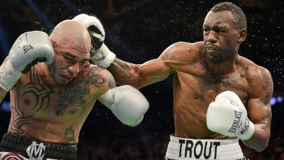 Miguel Cotto (l) receives his first boxing loss at Madison Square garden at the hands of Austin Trout.
