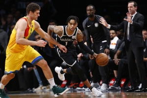 Brooklyn Nets guard D'Angelo Russell pushing past Milwaukee Bucks center, Brook Lopez on Monday, April 1, 2019, at the Barclays Center. The Brooklyn Nets lost to the Milwaukee Bucks 131-121.