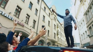 Odell Beckham surrounding by raving fans while promoting the NFL in Germany